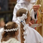 web3-children-going-to-the-first-holy-communion-0a-shutterstock_587731196
